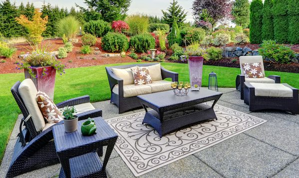 Picture of a decorative concrete backyard with full landscaping and lawn furniture for pro concrete contractor