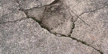 Close up picture of a cracked concrete that needs to be repaired by our customer in Detroit, MI