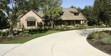 Picture of a new concrete driveway installed in front of a ranch home for our customer in Detroit, MI