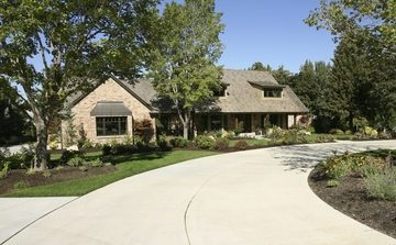 Picture of a long concrete driveway poured in front of a new ranch home in Fort Wayne, IN