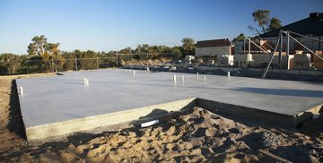 Picture of a newly poured concrete foundation for a new home being built by pro concrete contractor