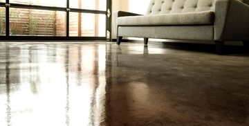 Close up picture of a brown stained concrete flooring in a downtown apartment in Detroit, MI