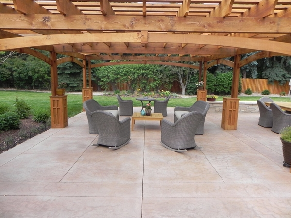 Picture of a stamped concrete patio with landscaping and outdoor furniture in Detroit, MI
