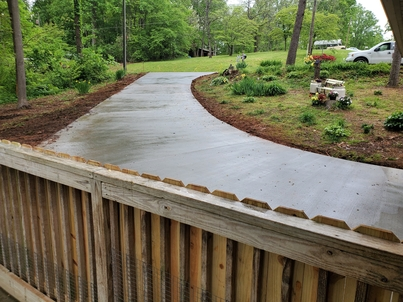 Picture of a concrete driveway that was installed in the back of our house in Flint, MI.