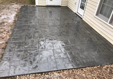 Picture of a stamped concrete patio in the back of the house in Macon, GA.