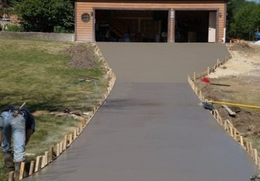 Picture of a new concrete driveway that was installed for a customer in Charlotte, NC