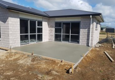 Picture of a newly poured concrete patio installed for a new home in Gainesville, FL.