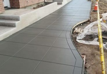 Picture of a new concrete sidewalk installed for a business in Jacksonville, FL