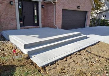 Picture of a new concrete porch and stairs that was installed for a new build in Charlotte, NC