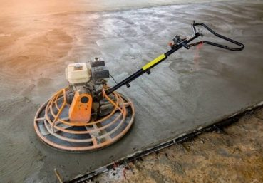 Picture of a concrete polisher being used to resurface a concrete driveway in Richmond, Va.