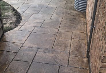 Picture of a stained and stamped concrete sidewalk installed for a customer in Atlanta, GA