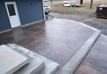 Picture of an a stained and stamped patio in a back yard for a customer in Tallahassee, FL.