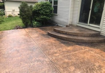 Picture of a stained and stamped patio installed for a customer in Madison, WI